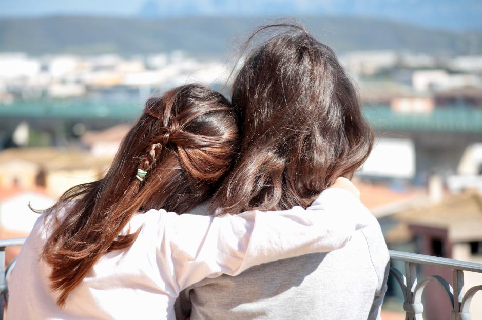 two people shoulder to shoulder
